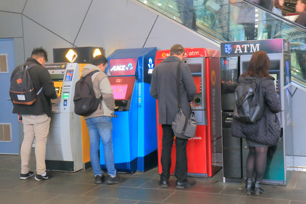 People using ATMs in Melbourne Australia