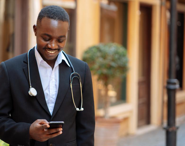 African doctor sending money via Mobile Money