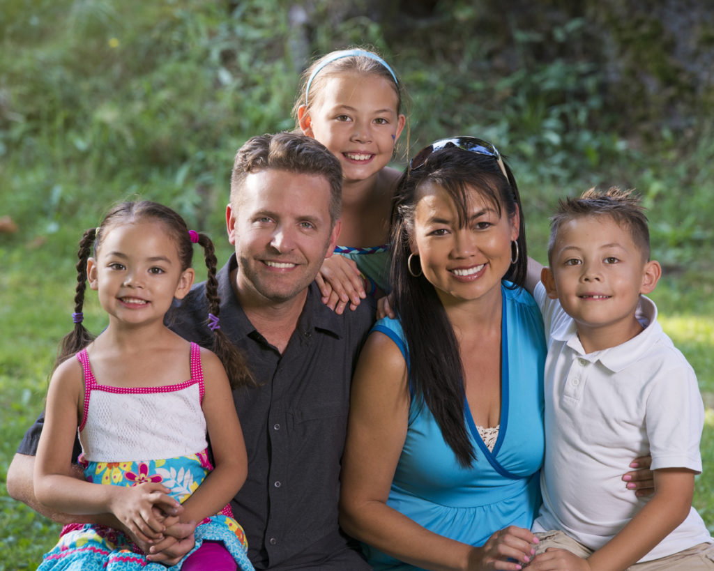 diverse family smiles